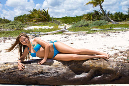 Young beautiful women in a Bikini on the sunny tropical beach Standard-Bild