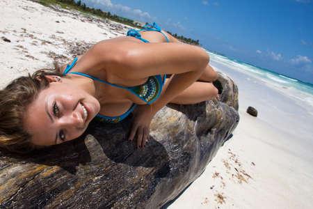 Young beautiful women in a Bikini on the sunny tropical beach Stock Photo