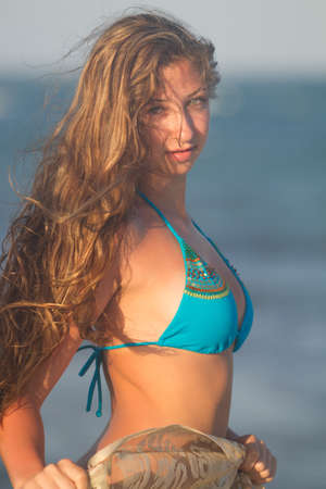 Young beautiful women in a Bikini on the sunny tropical beach at sunset Stock Photo - 14042125