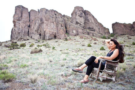 Beautiful Woman sitting out in Nature in a old Rocking Chair Stock Photo - 14042172