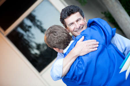 Father congratulating his son on graduation photo