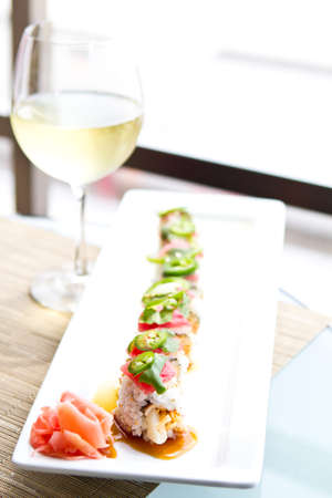 Sushi with tuna and a glass of White Wine photo