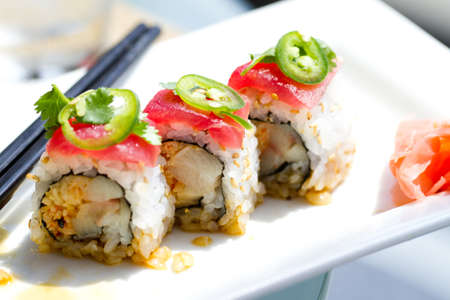 Sushi with tuna ,cilantro and Jalapeno peppers photo