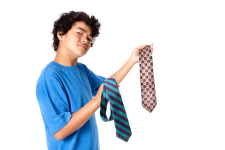 Asian Teenager picking out a tie for his dad on Father photo
