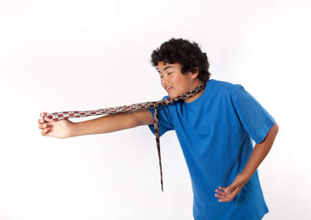 Asian Teenager picking out a tie for his dad on Father's day photo