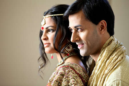 Gorgeous Indian bride and groom traditionally dressed Stock Photo
