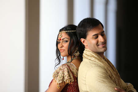 indian bride: Gorgeous Indian bride and groom traditionally dressed Stock Photo