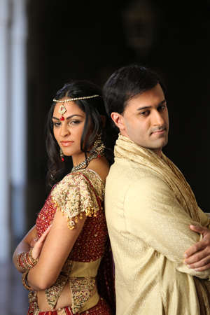 indian beauty: Gorgeous Indian bride and groom traditionally dressed Stock Photo