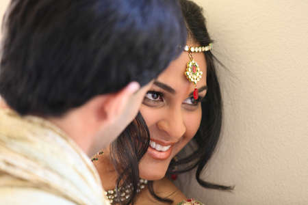 Image of a gorgeous Indian bride and groom traditionally dressed Stock Photo - 14121375