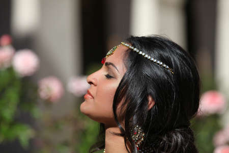 indian bride: Beautiful Indian Bride in Cathedral Hallway on her wedding day Stock Photo