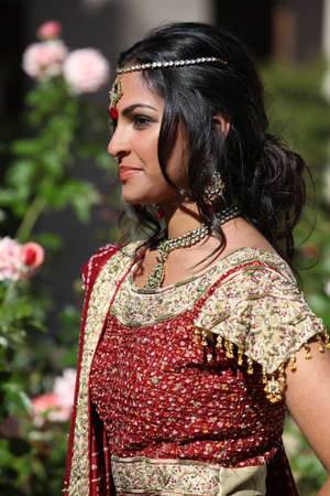 exotic dancer: Beautiful Indian Bride in Cathedral Hallway on her wedding day Stock Photo