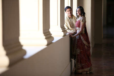 Image of a gorgeous Indian bride and groom traditionally dressed photo