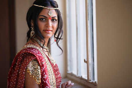 asian bride: Beautiful Indian Bride in Cathedral Hallway on her wedding day Stock Photo