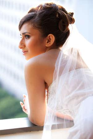 Beautiful Bride lit by sunlight photo