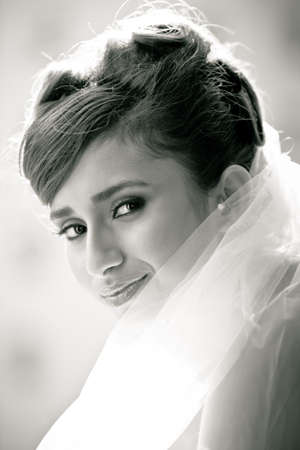 Black and white portrait of a Beautiful Bride Close up glowing from the sun light photo