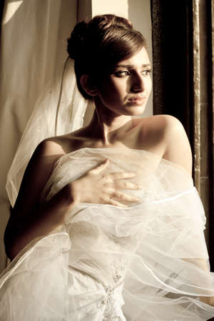 Beautiful Bride at Dusk lit by sunlight photo