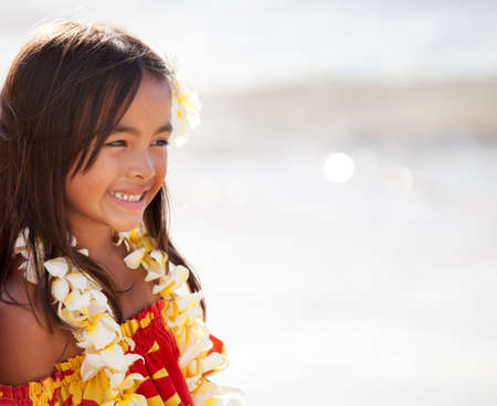 Pretty Hula Girl  at the beach wearing a handmade flower lei photo