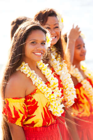 leis: Pretty Hula Girls  at the beach wearing handmade flower leis