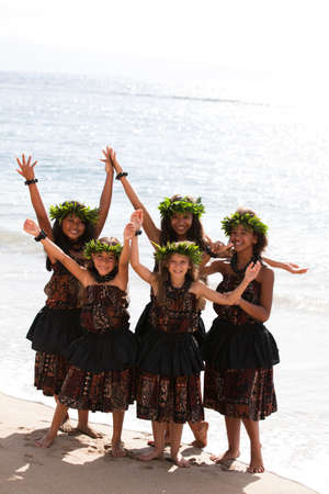 Hula girls on the beach with Hands raised Stock Photo - 14285550