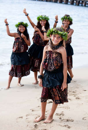 Hula girls on the beach with Hands raised in dance Stock Photo - 14285677