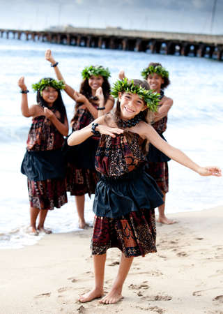 Hula girls on the beach with Hands raised Stock Photo - 14285575