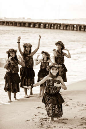Hula girls on the beach processed in aged sepia photo