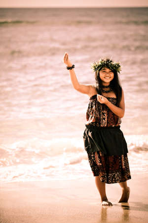 Pretty Hula Girl dancing by the ocean Stock Photo