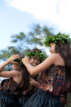 Hula girls on the beach getting ready to dance Stock Photo - 14285516