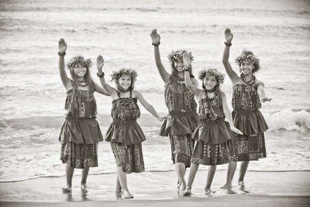 hawaii sunset: Hula girls on the beach in Black and white textured grain photo for aging effect