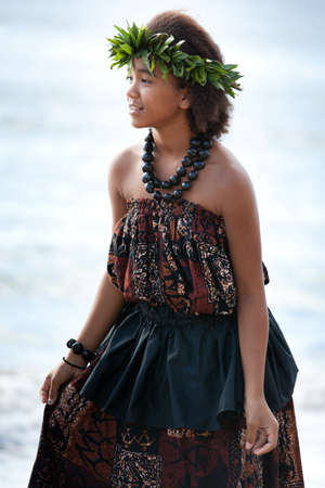 hula: Pretty Hula Girl dancing by the ocean Stock Photo