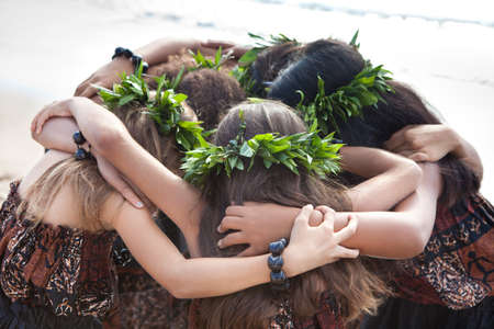 Hula Dancers coming together United as a team and friends photo