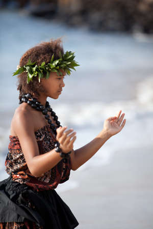 Pretty Hula Girl dancing at the beach wearing a handmade head piece photo