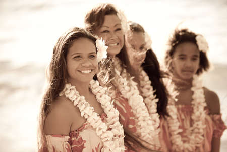 Pretty Hula Girl  at the beach wearing a handmade flower lei