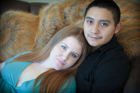 loo: Young mixed race couple happily waiting for their baby