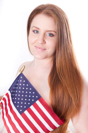 s stomach: Beautiful pregnant woman holding American flag with long red hair