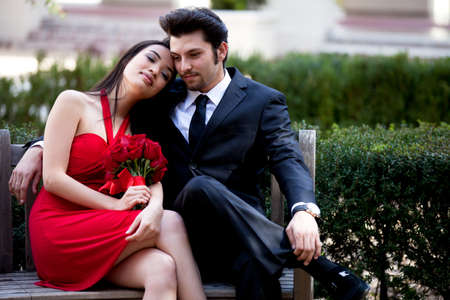 Happy couple smiling lenjoying a romantic moment Valentines Day or Wedding photo