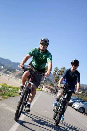 Father and Son Biking in Santa Monica California on the Bike Path photo