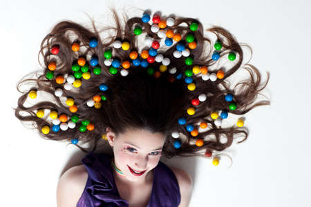 gumballs: Pretty Girl with Candy Makeup and colorful Gumballs in her hair for Artistic Fun