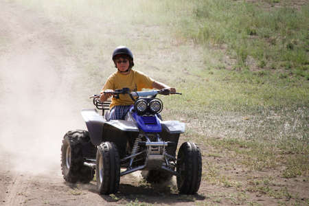 A Boy in Colorado having a blast on a Quad Runner photo