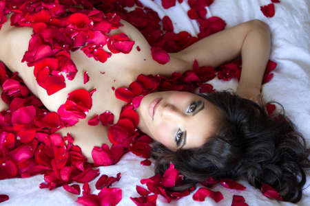 Gorgeous Woman in Rose Petals Stock Photo