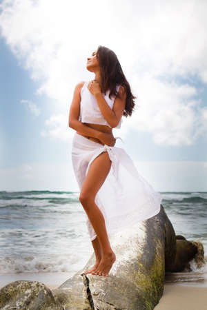polynesian: Beautiful Woman standing on driftwood in Kauai