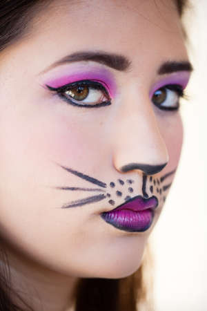 Pretty Brunette woman in cat makeup photo