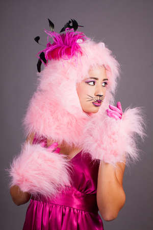 Pretty woman in cat makeup and Pink Costume photo