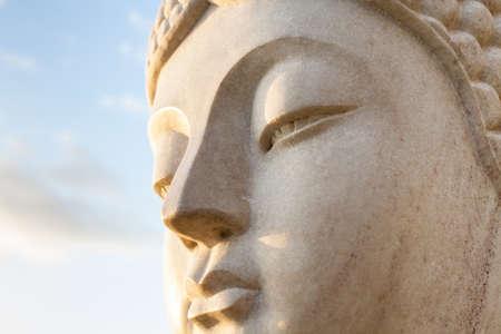stone buddha: Ancient Face of a stone statue of Buddha Stock Photo