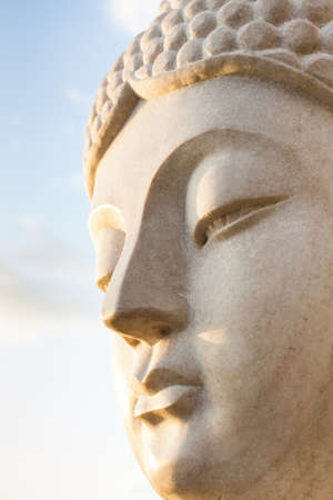 stone buddha: Face of a stone statue of Buddha