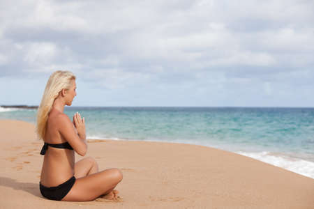 sun drenched: Sun drenched Blonde sitting in the Quiet of the Beach in Meditation