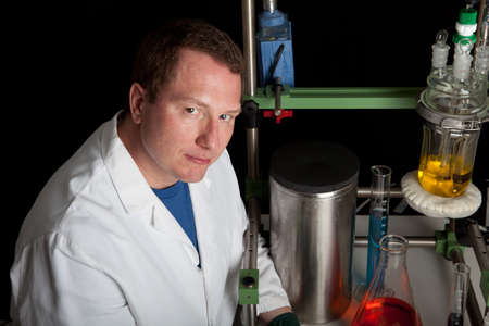 mid adult man: Scientist looking at camera Engaged in His Experiment