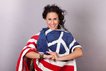 Woman draped in a Flag with a Peace Sign on it photo