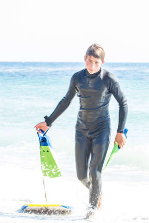 Young Man wearing a wet suit in the Ocean at Malibu California photo