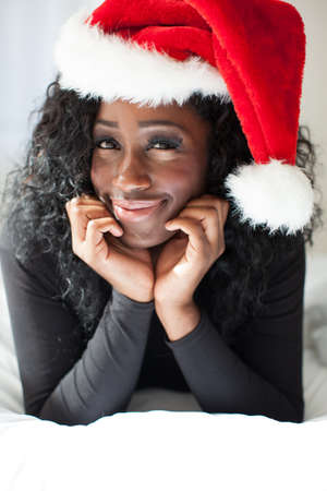 Pretty Woman in Black wearing a Santa Hat photo